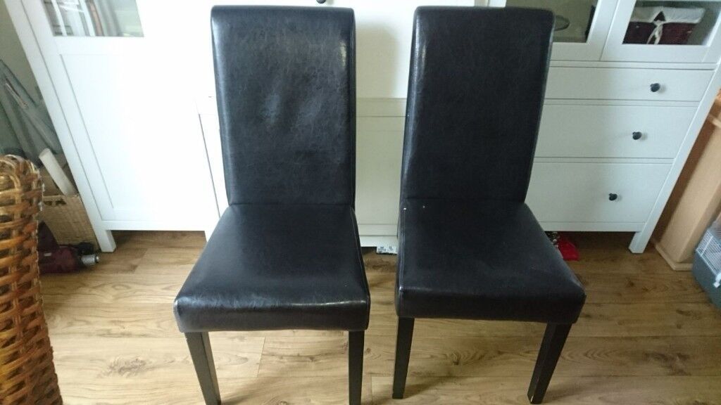 Two faux leather dinning chsirs