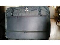 Large dark green suitcase