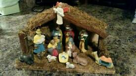 Porcelain nativity set with wooden stable