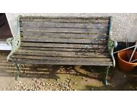 Used garden bench with cast iron sides, wooden slats need replacing