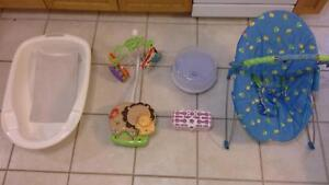bath tub, crib side mobile,  bouncing chair & bottle sterilizers