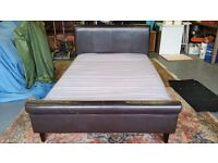 Double bed, brown leather look, sleigh headboard and footboard, with mattress, good condition