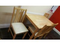 Solid pine table and 4 cushion chairs