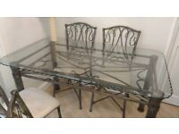 Glass top table (3' x 5') base is metal frame work - 6 chairs with cream unpholstered seats