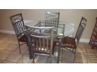 Glass & metal dining table & 4 chairs