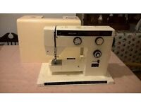 Sewing machine (electric) with many accessories