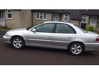 Vauxhall Omega 2.6 V6 in silver automatic luxury saloon with under 97,000 miles on the clock