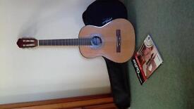junior guitar, case and book