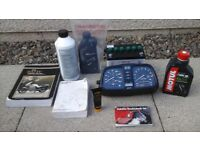 BMW K100RS BITS - NEW BATTERY, CLOCKS, MANUALS AND SERVICE PARTS.