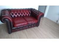 Oxblood red leather sofa