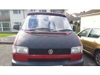 T4 transporter camper van with pop top roof