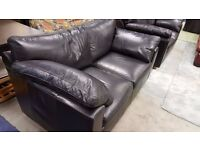 Two Black Two-seater Sofas in Excellent Condition