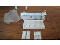 WII REMOTE QUAD DOCKING STATION WITH BATTERIES NEW IN PACK