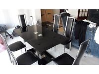 Black glass dining table, 6 chairs, coffee table and TV stand.