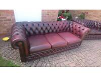 A Thomas Lloyd ox blood red leather Chesterfield 3 seater sofa