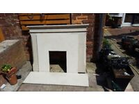 Stone fire surround, marble hearth and back panel