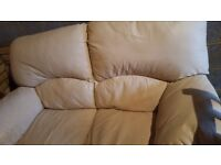 Beige Leather two seater sofa and single armchair.