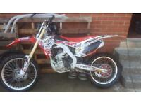 Honda CrF 250 Twin Pipe exhaust.