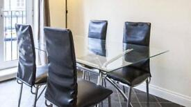 Glass dining table and 4 black leather style chairs