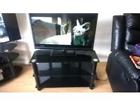 32 inch LCD TV with built in DVD player and glass stand.