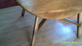 Ercol Table and Two Chairs.