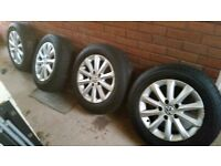 set of four wheels and tyres
