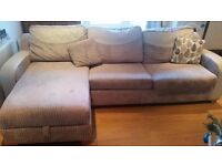 3 seater L-shaped sofa bed with storage and cushions