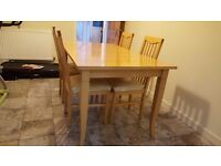 Wooden dining table and four matching chairs. Grab early season bargain