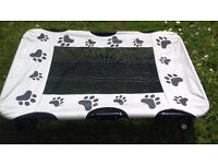 Raised Folding dog bed, perfect for travel.