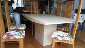 Contemporary solid marble table and 6 chairs.