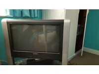 32 inch sony tv in sillver with matching stand