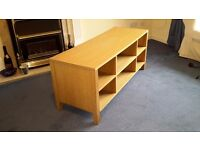 TV-HOME ENTERTAINMENT STAND IN OAK WITH SIX COMPARTMENTS 46 INCHES LONG EXELLENT CONDITION.
