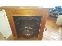 **BEAUTIFUL CAST IRON FIREPLACE AND WOODEN SURROUND**