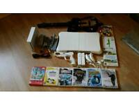 Wii Console with 9 games plus accessories
