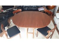 Wooden folding table with four chairs