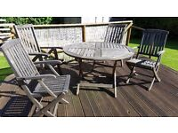 Hard wood set of garden furniture comprising of four foldaway chairs and foldaway round table