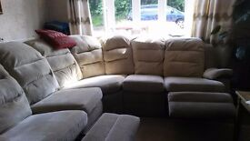 family size settee beige colour and reclines.