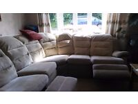 Reclining family size settee beige colour.