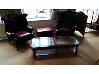 Chesterfield leather footstool, Fridge, glass coffe table, wooden wine rack