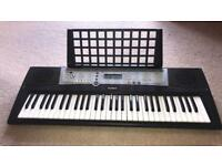 Yamaha Electric Keyboard YPT200 Includes the stand and the plug