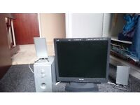 Computer monitor and speakers.