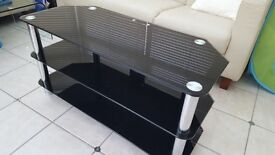 Black glass tv stand available for sale