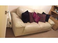 Cream Leather Two-Seater Sofa with Cushions