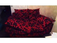 2 seater Red and black swirel design couch