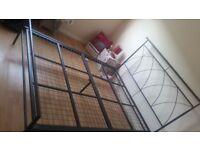 Good condition black metal bed frame.