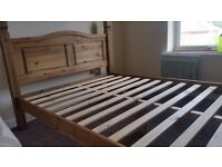 Solid wood double bed.