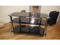 Black, glass television stand. Good condition.