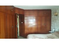 Beautiful wooden fitted wardrobes with dresser and bedside cabinets for sale.