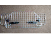 Mesh dog guard for car - adjustable size / shape - fits behind the seats, clips to headrest