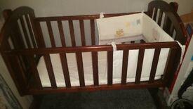 Obaby Sophie Swinging Crib in Walnut Wood. New